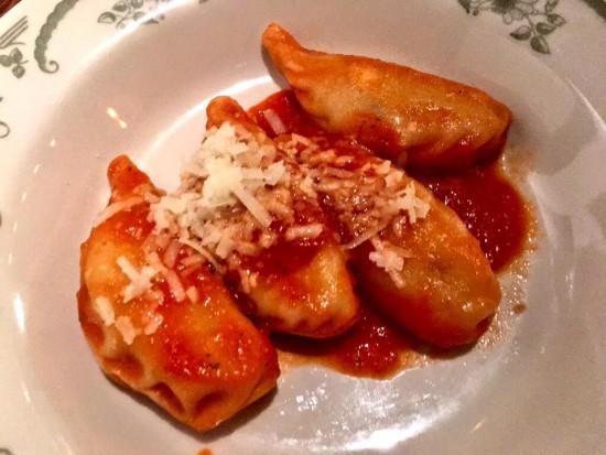 Sardinian-style Potato-Mint Ravioli with tomato sauce and grated Pecorino Sardo.