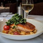 Pan-Seared Salmon (Recipe serves 4) Blistered Tomato Ragoût, Ricotta Gnudi, Wild Mushrooms,& Balsamic-Scented Watercress by Michael's on East, Sarasota, Florida